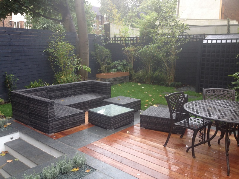 granite paving with hardwood decking and horizontal softwood painted fence