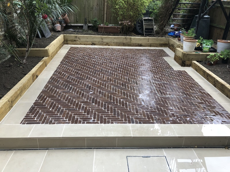 Brick pavers patio with sleepers and sandstone edge in Camberwell